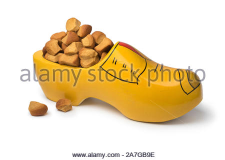 Traditional Dutch wooden shoe filled with pepernoten isolated on white background - Stock Photo