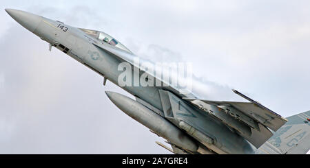 US Navy Super Hornet (F/A-18E) jet fighter during a flight demonstration at Airshow London, in London, Ontario, Canada. - Stock Photo
