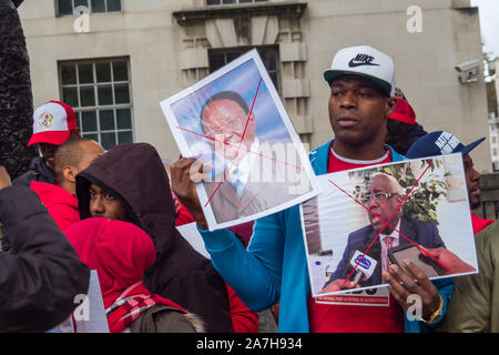 London, UK. 2nd November 2019. Guineans  from the  National Front for the Defence of the Constitution (FNDC) protest at Downing St against a constitutional change which would allow President Alpha Conde to seek a third term in power, and called for him to go.  The London protest followed massive protests in Guinea in October that led to 11 deaths. Protesters are angry that funerals have been delayed as the  government has not released the bodies to the families yet and call for all political prisoners to be released. Peter Marshall/Alamy Live News - Stock Photo
