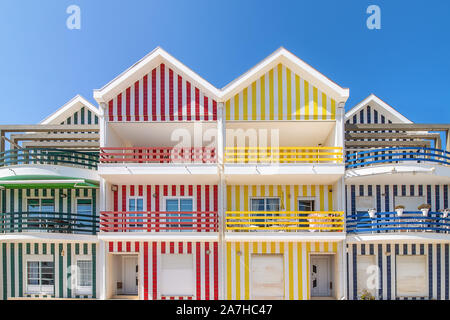 Street with colorful houses in Costa Nova, Aveiro, Portugal. Street with striped houses, Costa Nova, Aveiro, Portugal. Facades of colorful houses in C - Stock Photo