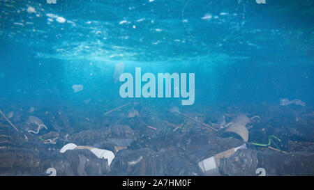 plastic pollution in ocean water, bags and bottles on the sea floor, micro plastic pollution - Stock Photo