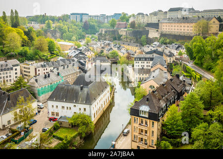 Alzette river bend with old houses along  reflected in water Luxembourg city, Luxembourg - Stock Photo