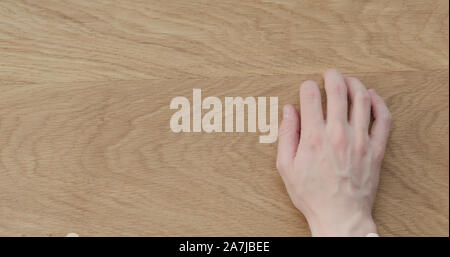 Top view man hand finger tapping on oak wood surface, wide photo - Stock Photo