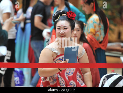 Beauties dressing in ancient Chinese clothes prepare to demonstrate and perform during the ancient Chinese clothing beauty pageant in Shenyang city, n - Stock Photo
