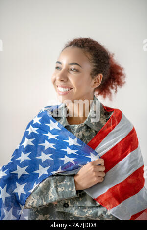 Young military woman feeling excited before going to work - Stock Photo