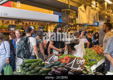 Shoppers in the historic Atarazanas Central Market, Malaga, Costa del Sol, Malaga Province, Andalusia, southern Spain. - Stock Photo