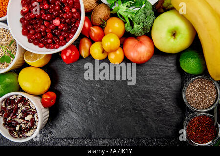 Alkaline diet food, Clean eating. Healthy vegetarian seasonal, fall food cooking background. Flat lay of Autumn vegetables and herb over grey concrete - Stock Photo