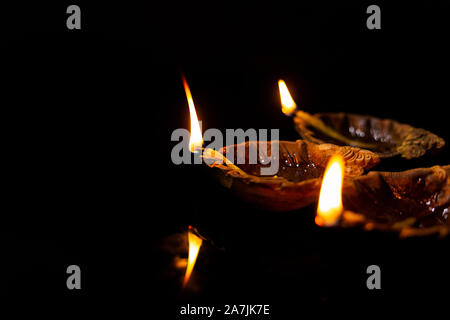 Close-up Burning Diya Oil-lamps lighting on-the Diwali festival Celebration Nobody - Stock Photo