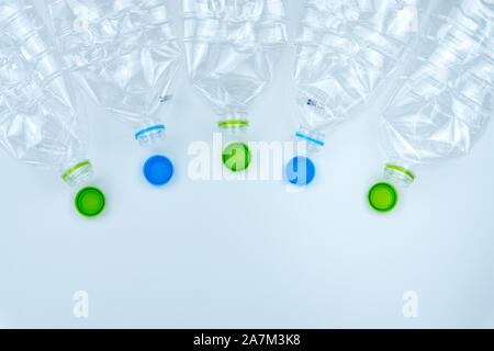 Recycling. The frame of used plastic bottle on white background with copy space. Recycle and reuse concept