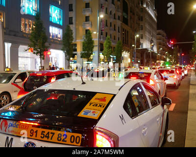 Madrid, Spain - Sept 2019: Car taxi traffic in downtown madrid gran via at night - Stock Photo