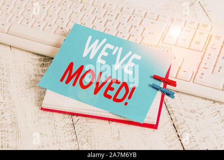 Writing note showing We Ve Moved. Business concept for To go from one residence or location to another Relocate notebook reminder clothespin with pinn - Stock Photo