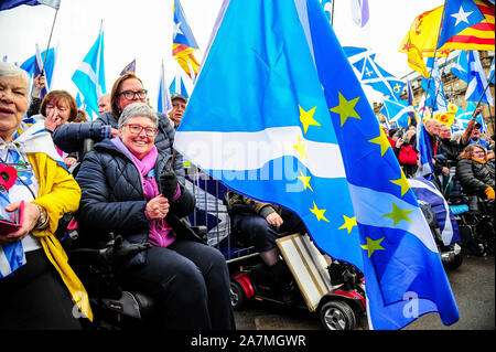 Glasgow, UK. 02nd Nov, 2019. An independence supporter holds her Scotland in Europe flag during the IndyRef2020 rally hosted by The National Newspaper. Credit: SOPA Images Limited/Alamy Live News - Stock Photo
