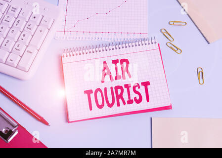 Handwriting text Air Tourist. Conceptual photo process of going from place to place by any flying object Paper blue desk computer keyboard office stud - Stock Photo
