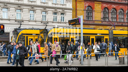 BUDAPEST, HUNGARY - MARCH 2019: People getting off a tram at a stop in Budapest city centre - Stock Photo
