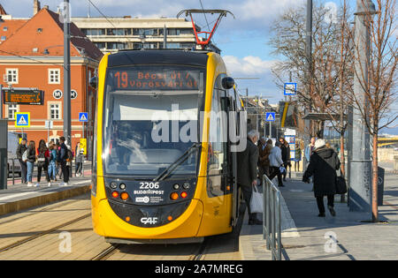 BUDAPEST, HUNGARY - MARCH 2019: People getting off a modern electric tram at a stop in Budapest city centre - Stock Photo