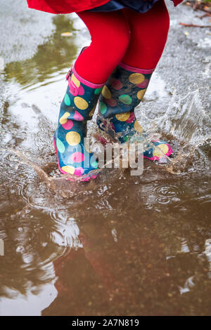 Splashing in muddy puddles - Stock Photo