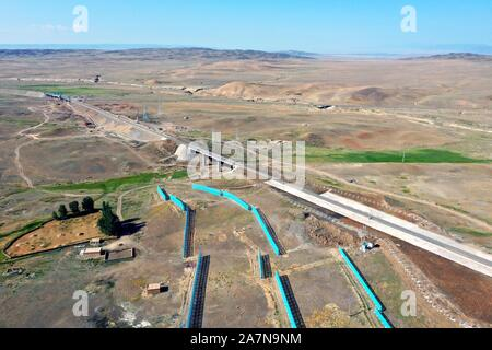 A train runs on the section between Kuytun and Tacheng Prefecture of the Karamay-Tacheng railway line in northwest China's Xinjiang Uygur Autonomous R - Stock Photo