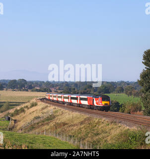 London North Eastern railway  ( LNER ) intercity 125 train passing How, Cumbria on the Tyne valley line with a diverted east coast train - Stock Photo