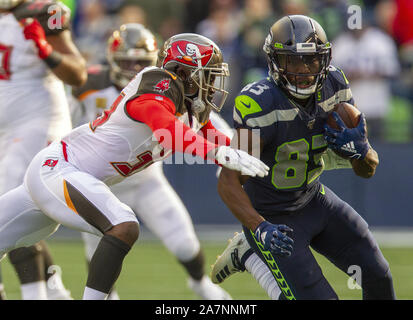 Seattle, United States. 03rd Nov, 2019. Seattle Seahawks wide receiver David Moore (83) picks up first down yardage against Tampa Bay Buccaneers cornerback Carlton Davis (33) second quarter at CenturyLink Field on Sunday, November 3, 2019 in Seattle, Washington. The Buccaneers lead the Seahawks 21-13 at halftime. Jim Bryant Photo/UPI Credit: UPI/Alamy Live News - Stock Photo