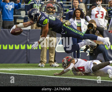 Seattle, United States. 03rd Nov, 2019. Seattle Seahawks tight end Jacob Hollister (48) drives over Tampa Bay Buccaneers defensive back Sean Murphy-Bunting (26) for a 1-yard touchdown during the second quarter at CenturyLink Field on Sunday, November 3, 2019 in Seattle, Washington. The Buccaneers lead the Seahawks 21-13 at halftime. Jim Bryant Photo/UPI Credit: UPI/Alamy Live News - Stock Photo