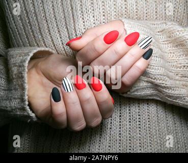 Close-up of young women with  multicolored nails gel manicure .Girl  with her hands behind. - Stock Photo