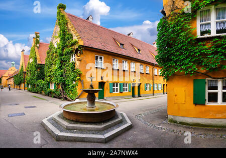 Augsburg, Germany, 08/03/2019: The Fuggerei is the world's oldest social housing complex still in use. It is a walled enclave within the city of Augsb - Stock Photo