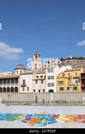 A view across the Segura river to the old town of Orihuela. On the other side can be seen the Episcopal Palace dome and the cathedral's bell tower. - Stock Photo