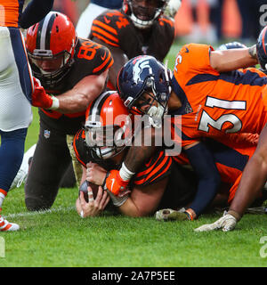 November 03, 2019: Cleveland Browns quarterback Baker Mayfield (6) is stopped short of a first down by Denver Broncos free safety Justin Simmons (31) in the second half of the game between Denver and Cleveland at Empower Field in Denver, CO. Denver hung on to win 24-19 to improve to 3-6. Derek Regensburger/CSM. - Stock Photo