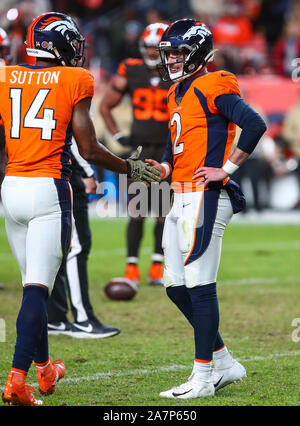 November 03, 2019: Denver Broncos quarterback Brandon Allen (2) is congratulated by Denver Broncos wide receiver Courtland Sutton (14) for his first NFL win at the end of the game between Denver and Cleveland at Empower Field in Denver, CO. Denver hung on to win 24-19 to improve to 3-6. Derek Regensburger/CSM. - Stock Photo