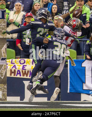Seattle, United States. 03rd Nov, 2019. Seattle Seahawks defensive back Marquise Blair (27) and strong safety Bradley McDougald (30) knocks the ball away from Tampa Bay Buccaneers wide receiver Mike Evans (13) during the fourth quarter at CenturyLink Field on Sunday, November 3, 2019 in Seattle, Washington. The Seahawks beat the Buccaneers 40-34 in overtime. Jim Bryant Photo/UPI Credit: UPI/Alamy Live News - Stock Photo