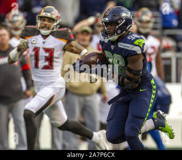 Seattle, United States. 03rd Nov, 2019. Seattle Seahawks defensive end Rasheem Green (98) returned a Tampa Bay Buccaneers quarterback Jameis Winston (3) fumble during the fourth quarter to the Tampa Bay 15-yard line at CenturyLink Field on Sunday, November 3, 2019 in Seattle, Washington. The Seahawks beat the Buccaneers 40-34 in overtime. Jim Bryant Photo/UPI Credit: UPI/Alamy Live News - Stock Photo
