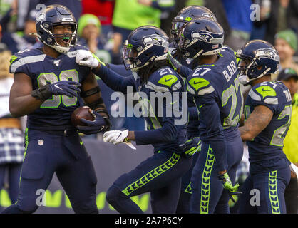 Seattle, United States. 03rd Nov, 2019. Seattle Seahawks defensive end Rasheem Green (98) is congratulated after he advanced a Tampa Bay Buccaneers quarterback Jameis Winston (3) fumble and returned it to the Tampa Bay 15-yard line. at CenturyLink Field on Sunday, November 3, 2019 in Seattle, Washington. The Seahawks beat the Buccaneers 40-34 in overtime. Jim Bryant Photo/UPI Credit: UPI/Alamy Live News - Stock Photo