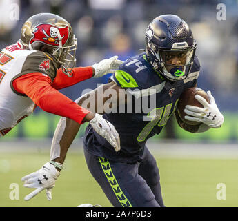 Seattle, United States. 03rd Nov, 2019. Seattle Seahawks wide receiver D.K. Metcalf (14) runs for a 14-yard gain against Tampa Bay Buccaneers defensive back Jamel Dean (35) during the fourth quarter at CenturyLink Field on Sunday, November 3, 2019 in Seattle, Washington. The Seahawks beat the Buccaneers 40-34 in overtime. Jim Bryant Photo/UPI Credit: UPI/Alamy Live News - Stock Photo