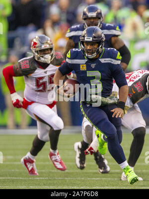 Seattle, United States. 03rd Nov, 2019. Seattle Seahawks quarterback Russell Wilson (3) scrambles against the Tampa Bay Buccaneers for a 21-yard gain during the fourth quarter at CenturyLink Field on Sunday, November 3, 2019 in Seattle, Washington. The Seahawks beat the Buccaneers 40-34 in overtime. Jim Bryant Photo/UPI Credit: UPI/Alamy Live News - Stock Photo
