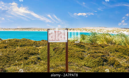 A sign near Stanley, warning that landmines may still be in the coastal area of Yorke Bay and Gypsy Cove, remaining from the Falklands War in 1982. - Stock Photo