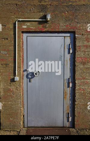 Silver door in concrete wall - Stock Photo