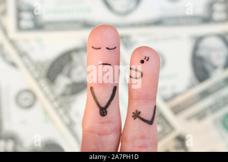Fingers art of family during quarrel on background of money. Concept of wife shouts on husband. - Stock Photo