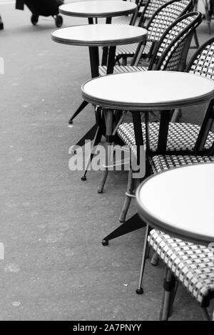 Paris, France. Cafe Terrace Table with Wicker Chairs. Classic French Cafe Monochrome View. - Stock Photo