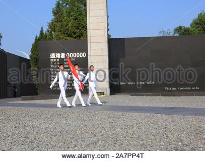 Representatives march during a flag-raising ceremony to commemorate the 74th anniversary of Japan's unconditional surrender in World War II at the Mem - Stock Photo