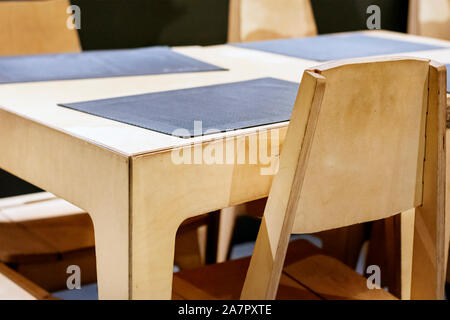 wooden table and chairs in a restaurant. Design furniture. - Stock Photo