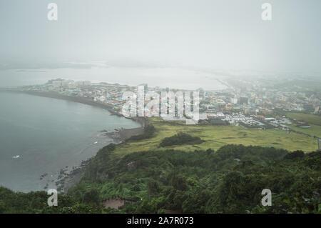 view from above on Seongsan on gloomy rainy  day - Stock Photo