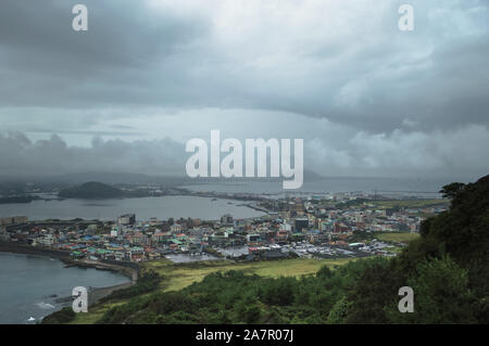 view from above  of Seongsan and sea on on cloudy day - Stock Photo