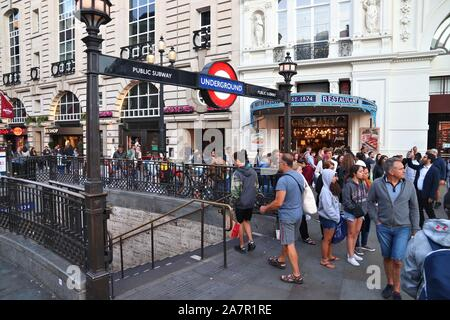LONDON, UK - JULY 14, 2019: Passengers enter London Underground station at Piccadilly Circus. London Underground is the 11th busiest metro system worl - Stock Photo