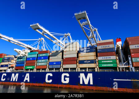 French owned, CMA CGM container ship being loaded, Port of Oakland, Alameda County, California, United States of America. - Stock Photo