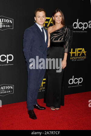BEVERLY HILLS, CA - NOVEMBER 03: Taron Egerton and Emily Thomas attend the 23rd Annual Hollywood Film Awards at The Beverly Hilton Hotel on November 03, 2019 in Beverly Hills, California.