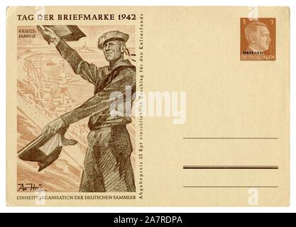German historical postal card: Postage stamp day 1942, Kriegsmarine sailor with signal flags, Adolf Hitler, ostland overprint, Germany, Third Reich - Stock Photo