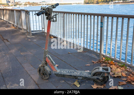 a dirty Circ electric scooter recovered from the Rhine stands on the banks of the Rhine, Cologne, Germany.  aus dem Rhein geborgener Circ Elektroscoot - Stock Photo