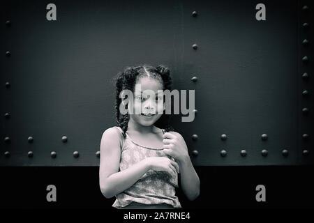 black and white portrait of mulatto girl with braids , havana - cuba - Stock Photo