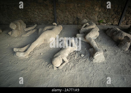 Pompei. Italy. Archaeological site of Pompeii. Orto dei Fuggiaschi / Garden of the Fugitives, plaster casts of bodies of people who died as they tried - Stock Photo