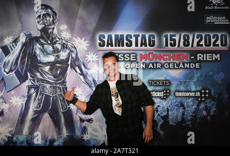 04 November 2019, Bavaria, Munich: Andreas Gabalier, Austrian singer, is standing in the press centre of Messe München at a press conference in front of a poster of his fan festival, which is to take place in August 2020. Photo: Felix Hörhager/dpa - Stock Photo